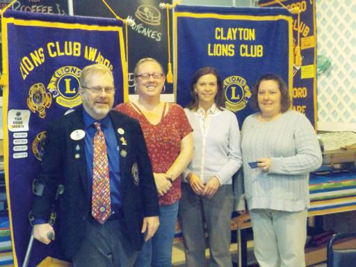 Lions District Governor John Burris, left, and Millsboro Lions Club member and co-sponsor Dr. Laurie Conti, center-left, welcome new Millsboro Lions Club members Catrina Arbeen, center-right, and Leigh Ann Smith, right.