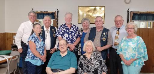 Millsboro Lions Club members and officers gather with Past District Mike Mock of the Milton Lions Club, second from right. Pictured, from left, standing, are: Past President David Mitchell, Tail Twister Alberta, Ryan Director Ted Parker, Lion Tamer Greg Ryan, Treasurer Mary Lee Phillips, President Chris Cordrey, Mock and Secretary Pat Sanzone. Seated, in front, are, from left: Membership Vincent Sanzone and Director Sandra Jones.