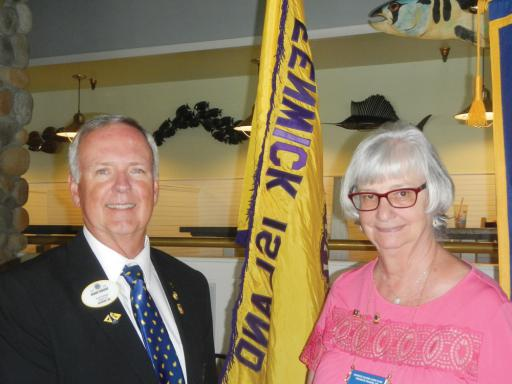 Delaware District Gov. Kenny Vincent congratulates Linda St. Clair after she is installed as Fenwick Island Lions Club president for 2019-2020.