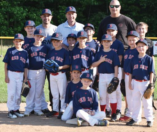 The Red Sox Little League team poses for a photo with William Reber, who is fighting cancer.