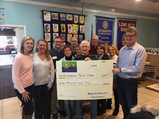 Long Neck Sunrise Rotary Club officers present their $1,000 donation to Operation Second Chance Chairperson Walt Ellenberger. Standing, from left, are: Val Ellenberger, Paulette Rappa, John Berner, Cathy Cardaneo, Howard Farrer, Lucille Cavan, Mike Hall, Mark Moscowitz, Kathy Williams, Connie Little, Judy Hall and Walt Ellenberger.