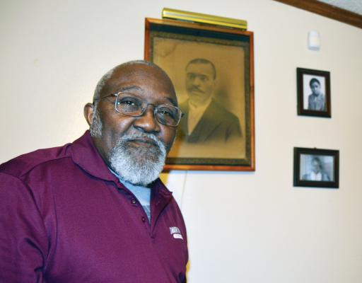 Lou Riley stands in front of portraits of his grandfather, Jacob Holland; his father, Louis Riley; and himself, at his Dagsboro home.