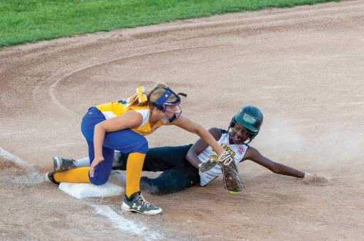 A Lower Sussex Little League All-Star player slides into third base during a game in 2018.