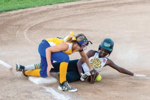 Laniya Lewis slides into third safe in the 14-1 win over Camden-Wyoming.