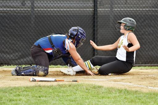 Lower Sussex's Katie McHale slides into home plate for a score against Maine on Tuesday, July 24.