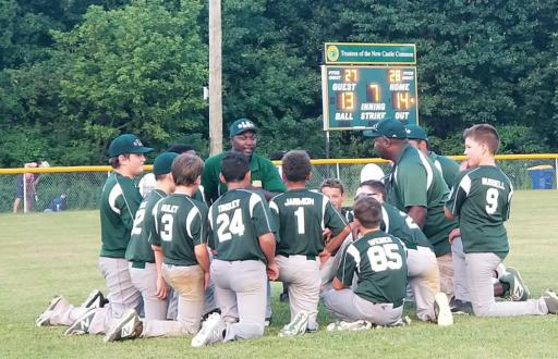 The LSLL Major Baseball team huddles during a game.
