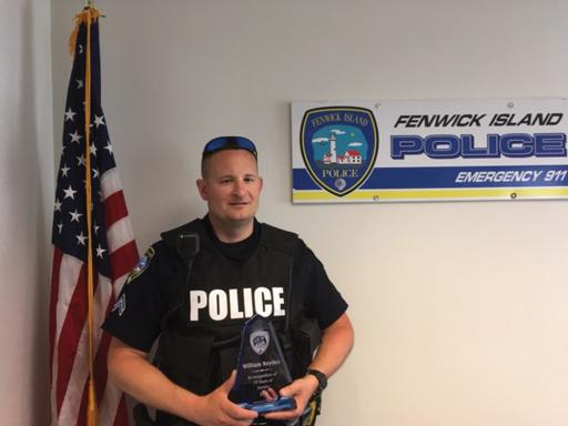 Cpl. Majewski poses with his service award for 15 years of service.