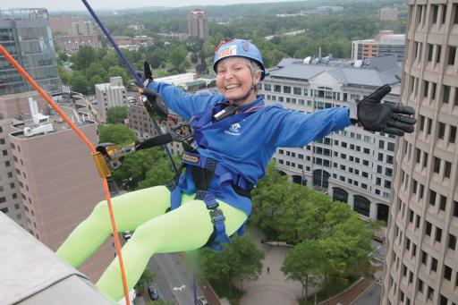 Marie McIntosh of Ocean View rappels 17 stories down the 300 Delaware Avenue building in Wilmington on May 9 to raise money for Special Olympics Delaware. In all, 91 people participated in the ninth annual 'Over the Edge' event, sponsored by TD Bank, Brandywine Realty Trust and New Castle County Fire Service. For more information or to sign up for next year, visit SODE.org.
