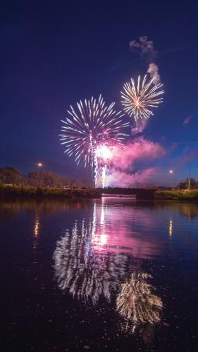 Fireworks light up the night sky and the water in Millsboro during last year's fireworks show.