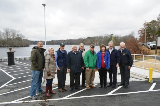 Officials gather at Millsboro Pond to celebrate the opening of the new boat ramp and parking upgrades.