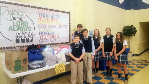 Most Blessed Sacrament Catholic School Student Council members, from left, Sean McCrystal, Casey Gabbard, Brendon Bradford, Tatum Vorsteg, Grace Short and Isabell Ashley, gather the donations to the group's recent coat drive.