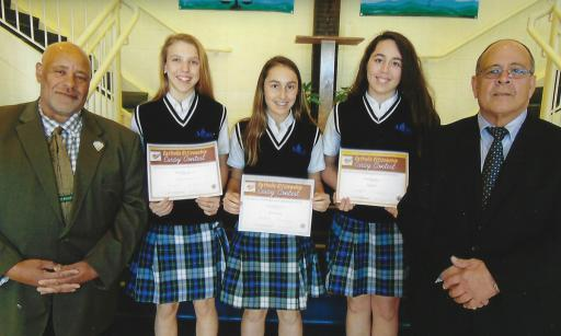 Robert Oliver, left, and Rich Glorioso, right, honoro participants in the Catholic Citizenship Essay Contest at Most Blessed Sacrament Catholic School including, from left, Sandra Pawlowska, Julia Carlson and Mia Diehl.