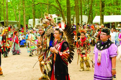 Native American dancers dance in the circle at the Nanticoke Indian Powwow.
