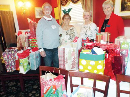 Members of NARFE Coastal Sussex Chapter 1690 survey Christmas gifts gathered at its December holiday luncheon before delivering them to three local nursing facilities in the area. Pictured, from left, are: James Justice, Pat Brady-Rice, Theresa Pitman and Martha Justice.