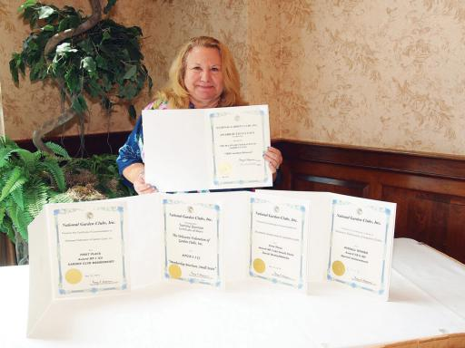 The National Garden Clubs organization recently recognized the Delaware Federation of Garden Clubs with an Award of Excellence for the group's 'TREE-mendous Delaware' tree planting at the Delaware Botanic Gardens.