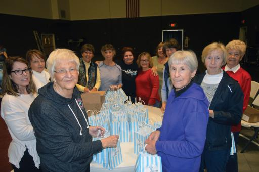 Volunteers filled goodie bags on Tuesday, Feb. 4 at the Ocean View Church of Christ, in preparation for Friday's Night to Shine event.