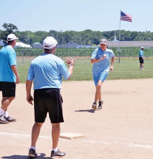 Old Tymers round third base in a game on Tuesday, July 10.