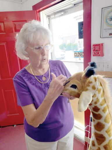 Judy Henninger spends some quality time with Gwendolyn.