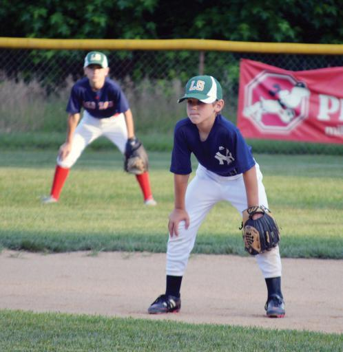 A couple of Pat Knight players are prepared in the outfield.