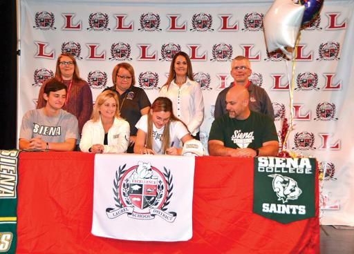 Laurel High School senior Nicole Patille signs a letter of intent to attend Siena College in New York, where she'll play softball. Shown with the Ocean View native, third from left, at last week's press conference are, from left: front row, her brother, Dominic Patille; her mother, Christine Patille; and her father, Michael Patille; and, back row, LHS assistant principal Rhiannon O'Neal, principal Stephanie Smith, softball coach Jodi Green and athletic director Jerry Mears.