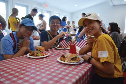 Hailing from China, from left, students Beisy Pan, Will Hoe and Giulienne Zheng enjoy St. Martha's picnic to welcome foreign students to the community.