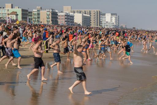 Polar Bear plungers rush into the Atlantic Ocean in Lewes on Saturday, Feb. 2. Event proceeds will go to support Special Olympics Delaware.