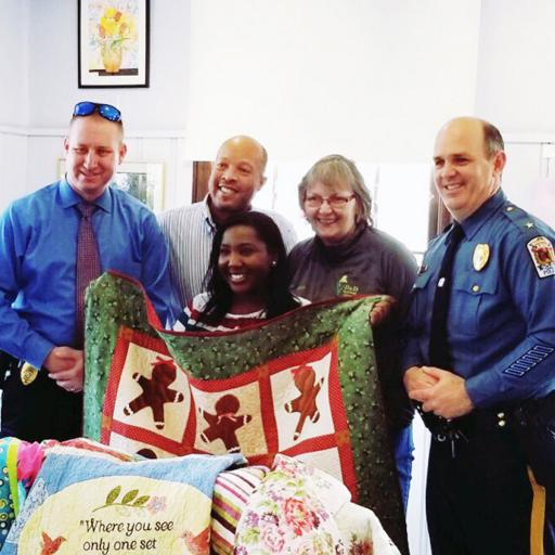 Representatives of the Millsboro Police Department accept quilts from the Millsboro Art League to donate to domestic violence victims. Pictured, from left, are: Lt. Robert Legates; quilter Skip Claiborne; Vonshea Wise, who works with those affected by domestic violence; Deb Doucette, director of the art league; and Millsboro Police Chief Brian Calloway.