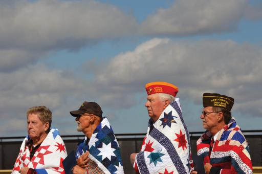 Veterans of the Vietnam War receiving Quilts of Valor during a ceremony Saturday, Oct. 5 at The Wall That Heals site at the Mason-Dixon V.F.W. Post 7234, Ocean View, include, from left, Rusty Fowler, Frank Mathers, Rich Kuhblank and John Mitchell.