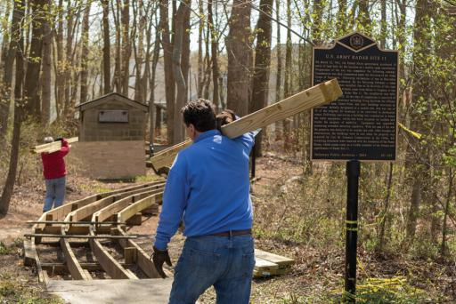 Bear Trap community members work on the boardwalk at the historic U.S. Army Radar Site.