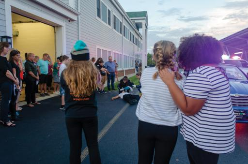 Students react as emergency responders simulate an overdose as part of an effort by local first-responders and Mariner's Bethel United Methodist Church to impact young people and parents on the dangers of opioids.