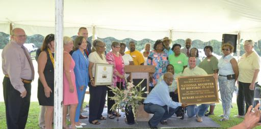 Volunteers and dignitaries celebrate the work already accomplished as they continue pressing toward a community center.