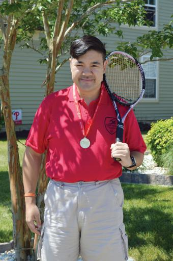 Special Olympics gold medal-winner R.J. Franco shows off the prize after his win.