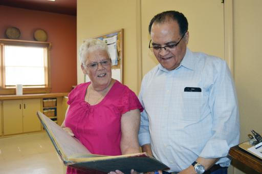 Michele Wright and Joe Harmon look over a guest book from the Rosedale Beach Hotel & Resort from the late 1960s during a Nanticoke Elders Gathering on April 28 at the Nanticoke Indian Center in Millsboro.