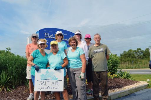 Members of the Salt Air Gardeners gather in front of the Bethany-Fenwick Area Chamber of Commerce where they worked to refresh the landscaping and infuse it with more native plants on Wednesday, June 27.