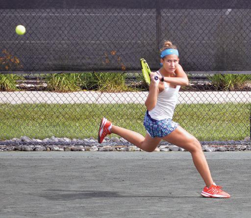 Zoe Howard (USA) watches as her two-hand return shot heads back toward her opponent  their opening qualifying match in the ResortQuest Pro Women's Tennis Open at Sea Colony on Monday morning.