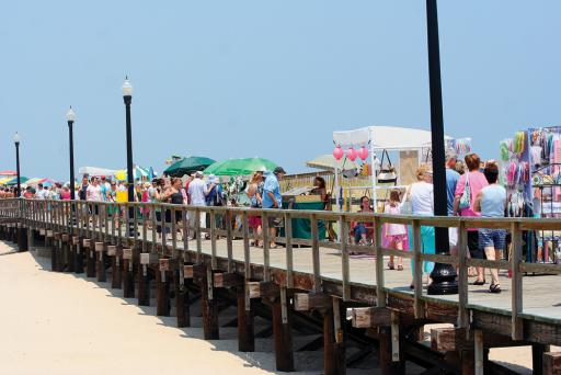 Beach-goers peruse the various crafts on display at a previous year's Seaside Craft Show on the boardwalk in Bethany Beach.