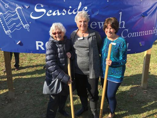 Seaside Jewish Community members Miriam Zadek, Marsha Davis and Allysa Simon pose for a photo at the synagogue's expansion groundbreaking on Sunday, Jan. 5.