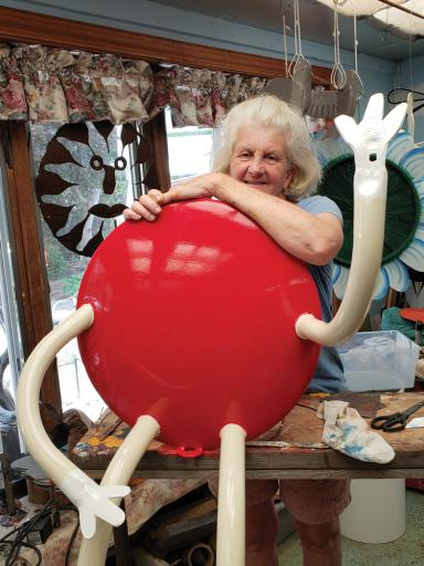 Judy Hagen, sculptor and co-owner of 2nd Time Designs, shows off a Red M&M's mascot, in progress.