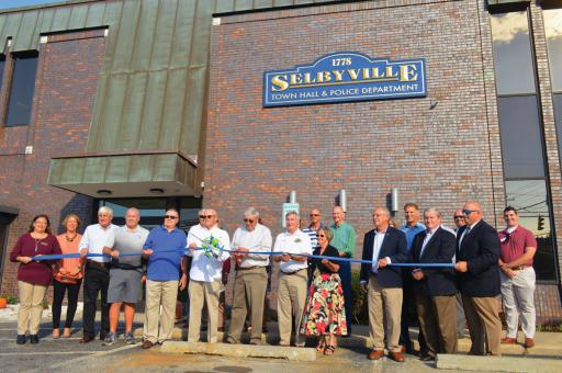 Selbyville council members, staff, police and special guests celebrated the grand opening of Selbyville Town Hall's new location.
