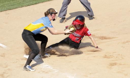 Canada's Emma Rautio-Roe slides into third against West's Natalie Goodman during last year's Senior League Softball World Series.