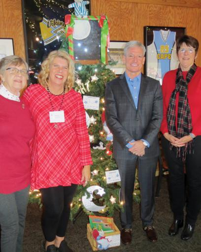 Read Aloud Delaware Sussex County Coordinator Stacy Penaranda, second from left, joins, from left, Sussex County Committee member Marge Bettors, tree sponsor Skip Faust and committee member Margaret Roe by the 'Goodnight, Moon' tree at Grotto's Grand Slam restaurant in Lewes. Faust has sponsored the Read Aloud trees for 10 years.