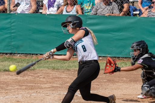 District 3's Taylor Wroten gets a solid hit during their 8-4 win over eventual champions Asia-Pacific on Thursday, Aug. 2.