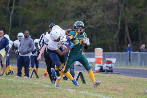 A Selbyville Middle School player fights a tackle during a game earlier this season.