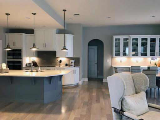Architectural lighting accentuates the kitchen of this inland home.