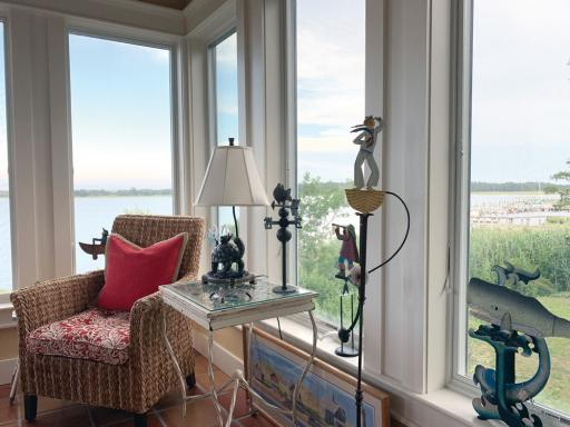 The owner's collection of balance toys frames views of the bay in this waterfront home, which will be featured on the Beach & Bay Cottage Tour on July 24-25.