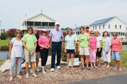 South Bethany canals got some love from residents in the 2018 annual Adopt-a-Canal contest. Here, town officials, volunteers and donors gather at the winning Kent Place location.