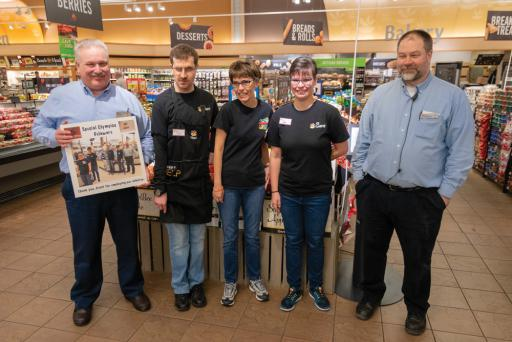From left, Bob Suttmiller, Colin Mullen, Andrea Kohler, Christine Arancio and Mike Hunt get together at the Giant Foods in Millville as the athletes present the store managers a plaque to thank them for hiring Special Olympics athletes.