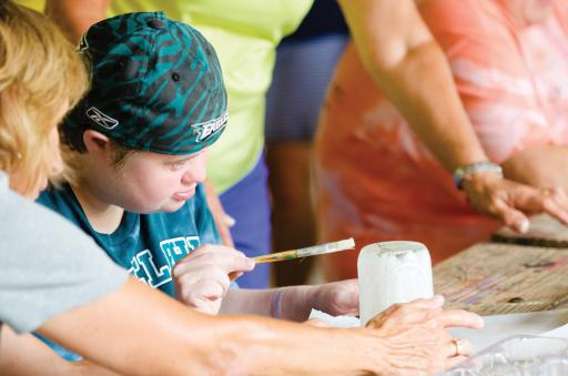 Special Olympics athletes get some arts and craft time in.