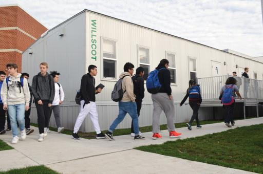 Sussex Central students have to go outside to get to the portable classrooms, and then back out to go into the main school again. Some days, the weather cooperates. Others? Not so much.