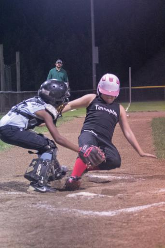 A runner from the Terrapins slides into homeplate during the 2018 Pat Knight softball championship game.
